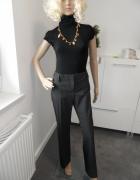 Szare spodnie marki H&M...