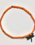 Bransoletka pomarańczowe koraliki zawieszka motyl ze stali srebrna