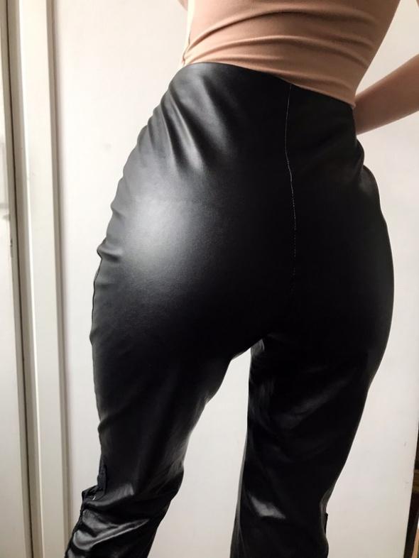Nowe spodnie z eko skóry Prettylittlething z metką