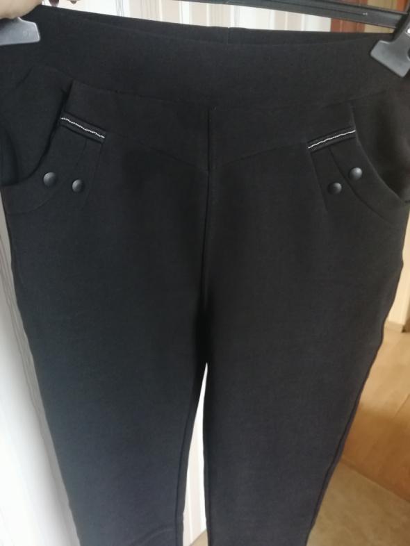 Wloskie spodnie r L XL