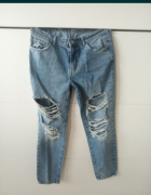 Jeansy z dziurami z przetarciami L 40 modne...