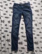 Elastyczne jeansy 38...