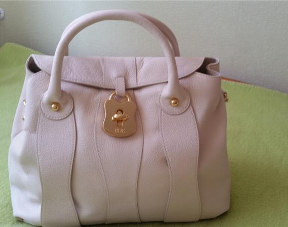 Piękna nowa skórzana torba w kolorze ciepłego beżu...