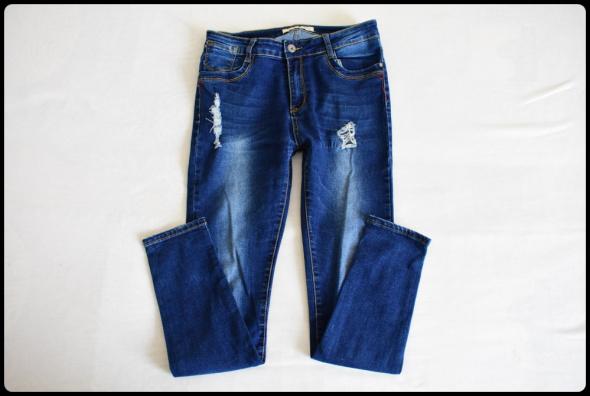 Spodnie jeansowe JEANSY 40 L elastyczne przetarcia rurki...