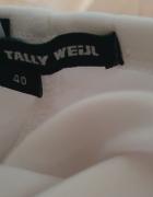 Biała sukienka bandażowa...