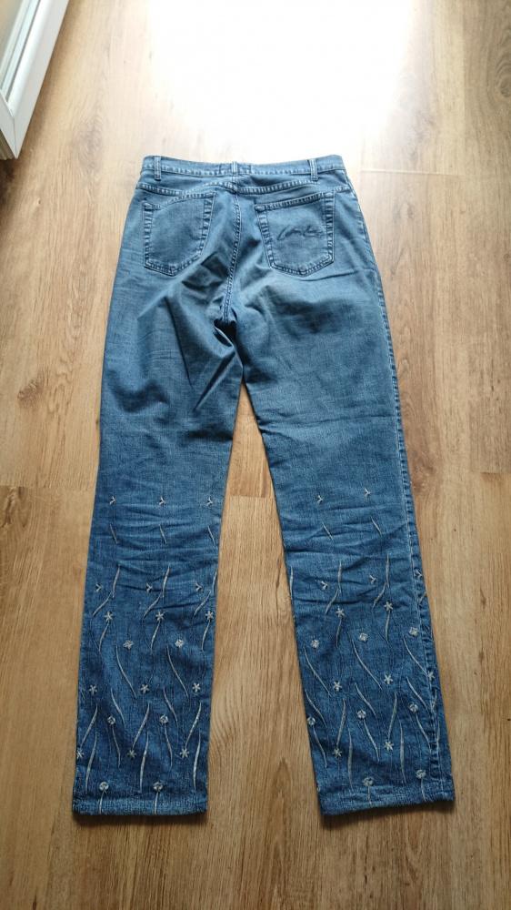Spodnie jeansowe damskie niebieskie zdobione w rozmiarze 32...