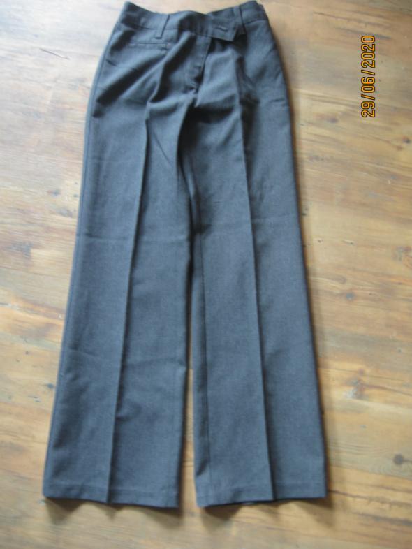 Eleganckie spodnie dla dziewczynki rozmiar 134