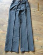 Eleganckie spodnie dla dziewczynki rozmiar 134...
