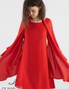 Czerwona sukienka biurowa dla kobiet na stanowisku De Marco...