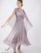 Balowa sukienka jedwabna na wesele w prestiżowym lokalu De Marc...