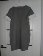 Elegancka krótka szara sukienka...