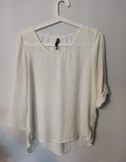 Lejąca kremowa bluzka...