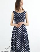 Rozkloszowana sukienka na uroczystości rodzinne w sezonie letni...