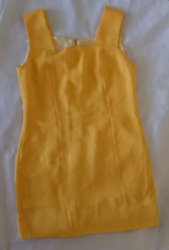 Żółta krótka sukieneczka rozmiar 38...