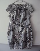 elegancka sukienka z kieszeniami...