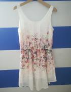 Biała sukienka w kwiatki...
