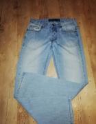 Spodnie Reserved W31 L34...
