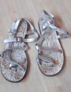 srebrne skórzane sandały skóra paski...