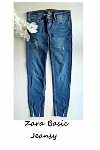 Jeansy z przetarciami Zara Basic...
