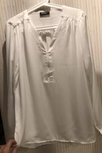 Elegancka biała koszula...