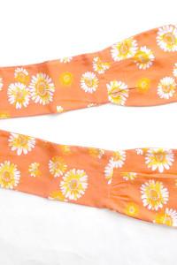 pomarańczowa opaska na włosy lub apaszka...