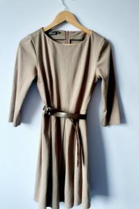 Elegancka beżowa sukienka...