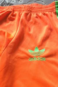 Spodnie adidas pomarańczowe...