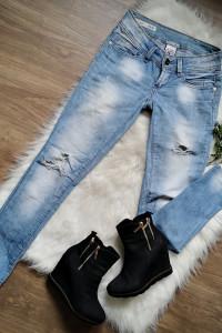 jeansy z dziurami Luxury...