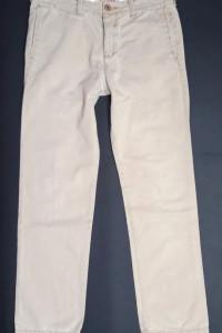 HOLLISTER Materiałowe męskie spodnie beżowe 32x32