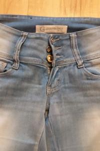 Spodnie S