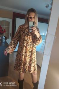 Sukienka krótka luźny fason wiązana pod szyja rozmiar 42...