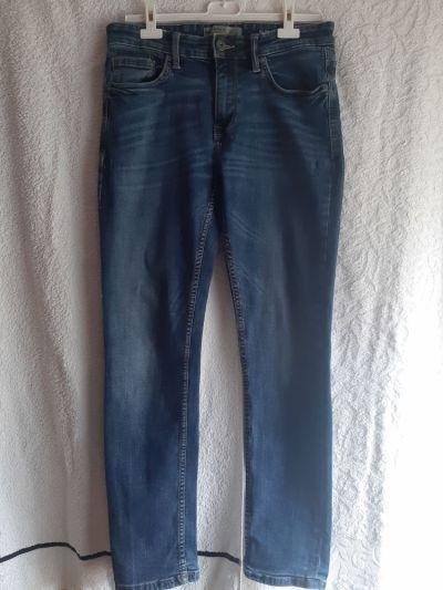 Spodnie Niebieskie jeansy Clockhouse slim stretch