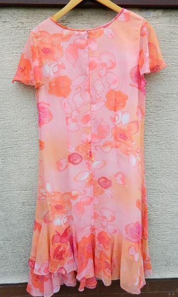 Suknie i sukienki Pastelowa sukienka z asymetrycznymi falbankami
