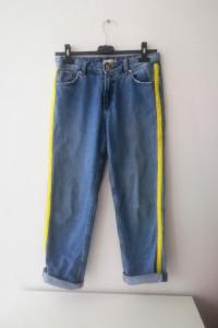 Niebieskie jeansy z seledynowym elementem Cropp...