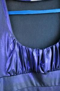 Fioletowa błyszcząca bluzka...