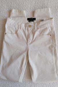 Białe jeansy Reserved...
