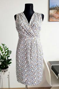 biała sukienka z wzorem...