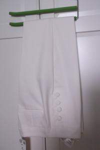 Kremowe spodnie cygaretki Orsay 38