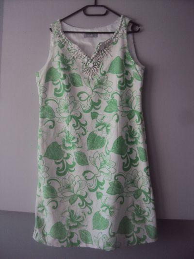 Suknie i sukienki elegancka sukienka z koralikami