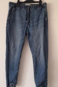 Bershka Niebieskie jeansy chinosy 40...