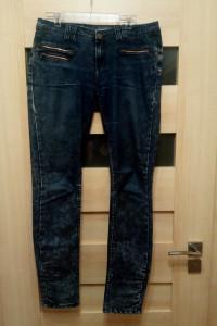 Spodnie biodrówki damskie fioletowe Reserved...