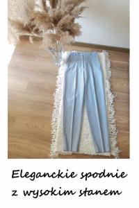 Eleganckie spodnie z wysokim stanem paski...