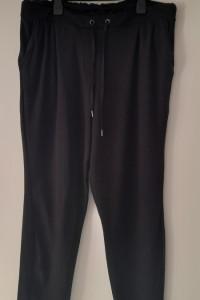Czarne elastyczne spodnie z falbanką 44 46...