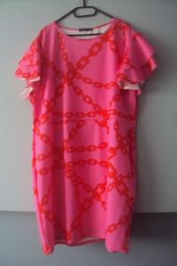 elegancka sukienka w łańcuchy...