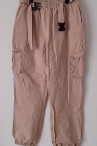 Różowe spodnie chinosy bojówki 42...