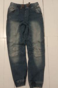 Spodnie ściągacze Next...