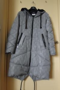 Właściwie nowy płaszcz Carry puchowy ciepły i lekki z kapturem duże L