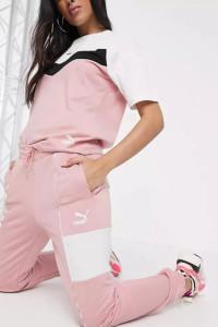 PUMA XTG Różowe spodnie dresowe XS...
