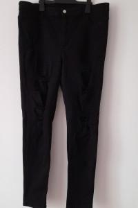 H&M Czarne jeansy rurki skinny z dziurami 50...
