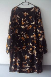 trapezowa sukienka z kieszenniami...